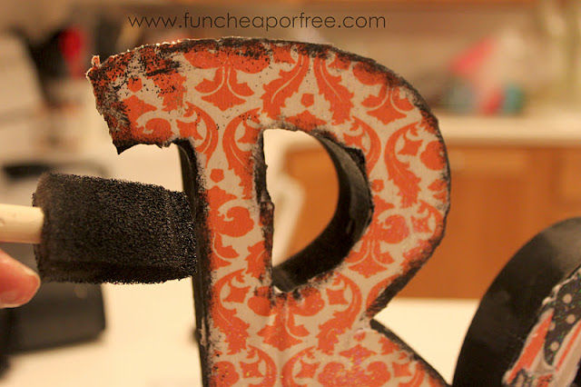 Putting paint on wooden letters, from Fun Cheap or Free