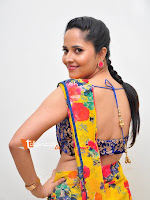 Anasuya in Yellow Saree Stills-cover-photo
