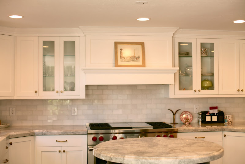 White kitchen w/brass hardware. The backsplash is Thassos marble and  title=