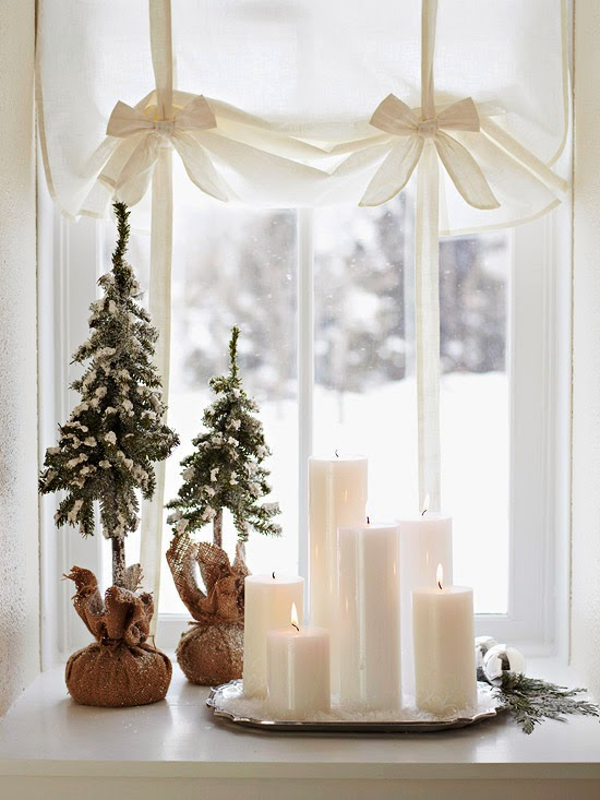 Simplicity Is Key For Small Space Decorating White Pillar Candles Placed On A Silver Tray Add Elegance To Windowsill Two Faux Dwarf Evergreens