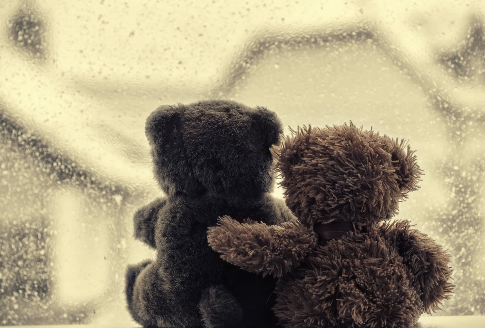 Teddy bears hugging to signify love between a parent and child