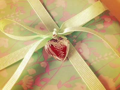 Romantic wedding gift wrapping with a locket