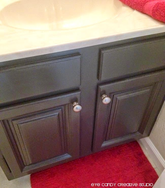 after photo of repainted bathroom cabinets, expresso colored cabinets