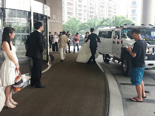Bridal  party leaves hotel in Pudong Shanghai