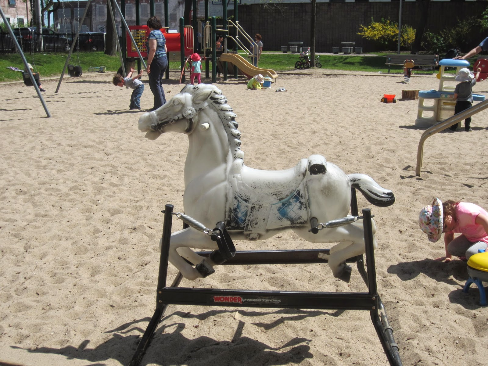 classic rocking horse, abandoned toys in a playground