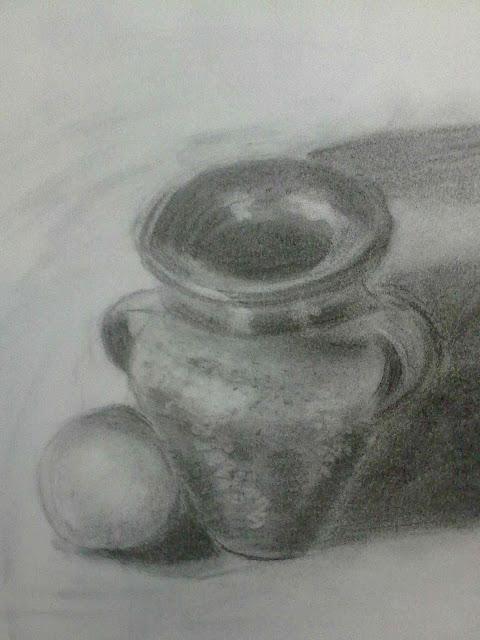 esfera y jarron a carbon