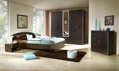 dormitorio azul y marrón