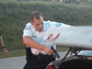 Officer Alex Hons practices searching a vehicle at the academy.