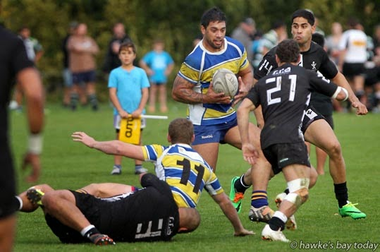 With ball: Jess Tuhua, Clive - rugby vs Napier Pirates at Park Island, Napier. Pirates won 26-25 photograph