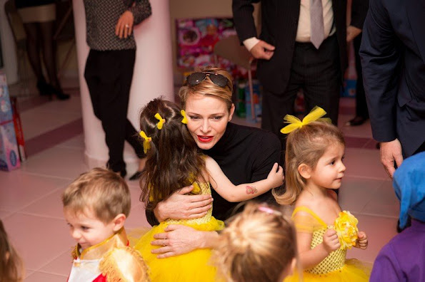 "Prince Albert and princess Charlene of Monaco presented gifts to old people and children at ""Red Cross"" Monaco branch"