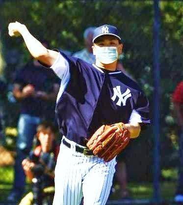 Masahiro Tanaka pitching with surgical mask
