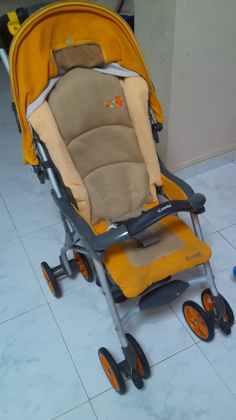 Things for Sell: WTS: Combi Stroller Tm359 (Orange)