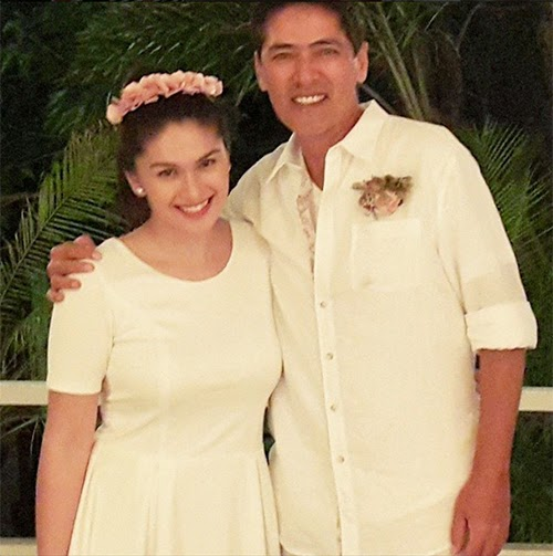 Vic Sotto and Pauleen Luna appear in a wedding photo