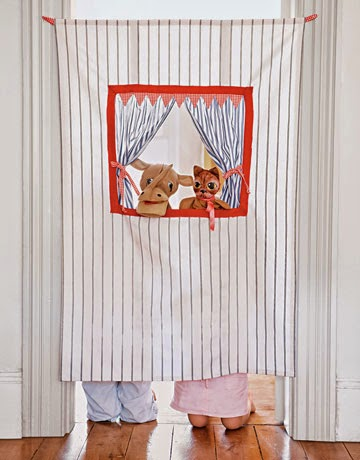 http://www.countryliving.com/crafts/projects/doorway-puppet-theater-0609