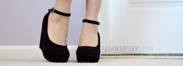 Milanoo's simple black ankle-strap wedge pumps are easy to wear and go great with nearly any outfit.