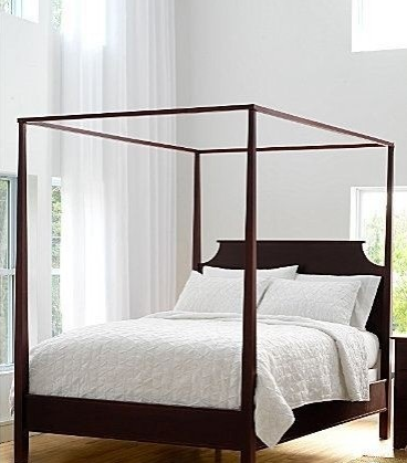 Vintage A simple wood frame four poster bed is simple but packs a big punch Fabric can be added to the frame to create a more luxurious and softer feeling