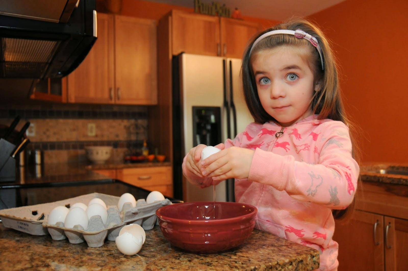 Little Girl Cracking Eggs