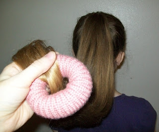 . Bring the last few inches of hair through center of bun maker