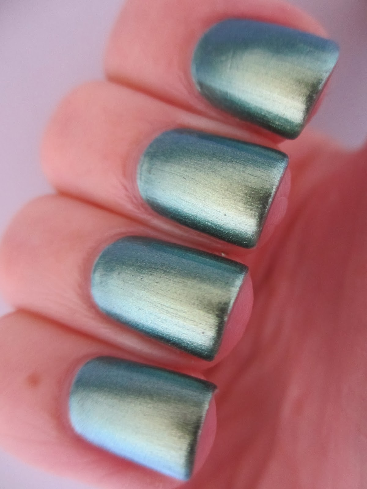 Claire's-Dollar-blue-green-duochrome-swatch-nail-polish