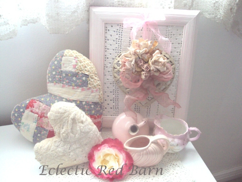 Vintage quilted hearts, framed metal heart, small pink pitchers,and varigated rose