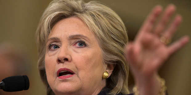 Hillary Diane Rodham Clinton faces off Libya critics