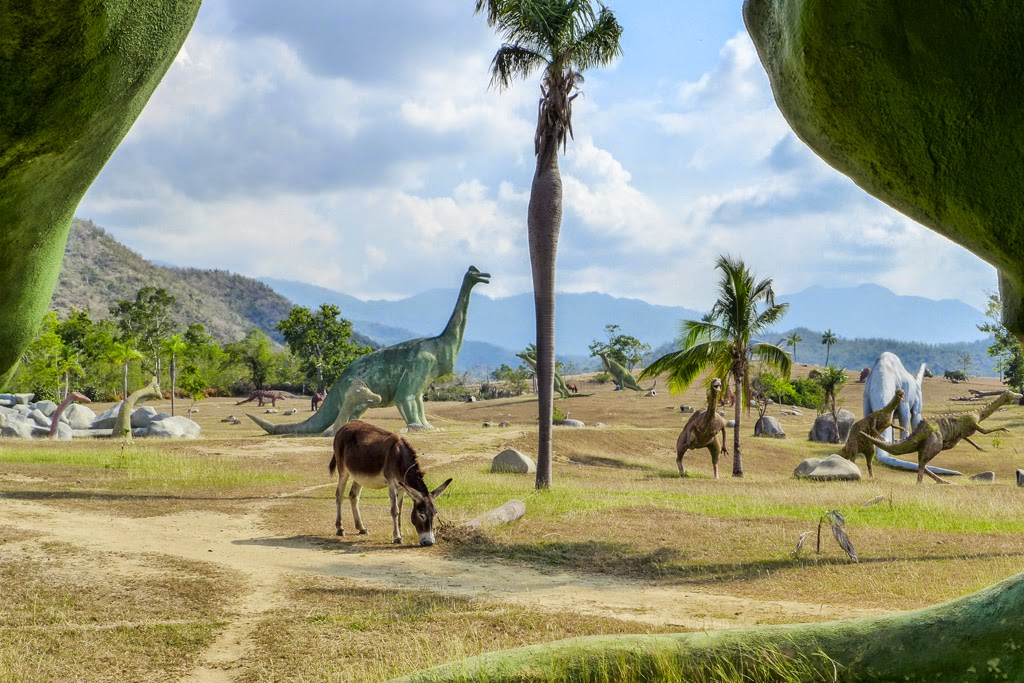 Baracoa Park Prehistoric Park grazing donkey among the dinos