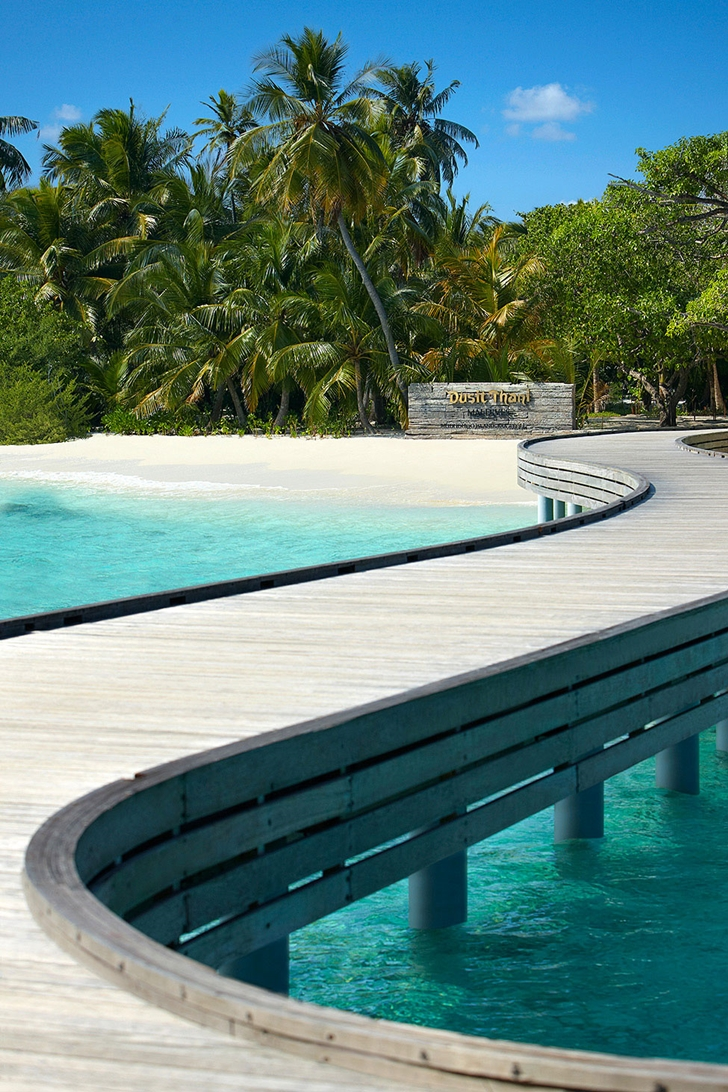 Wooden walkway in Luxury Dusit Thani Resort in Maldives