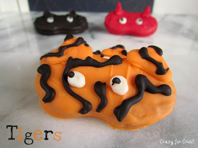 nutter butter cookies decorated to look like tiger halloween masks