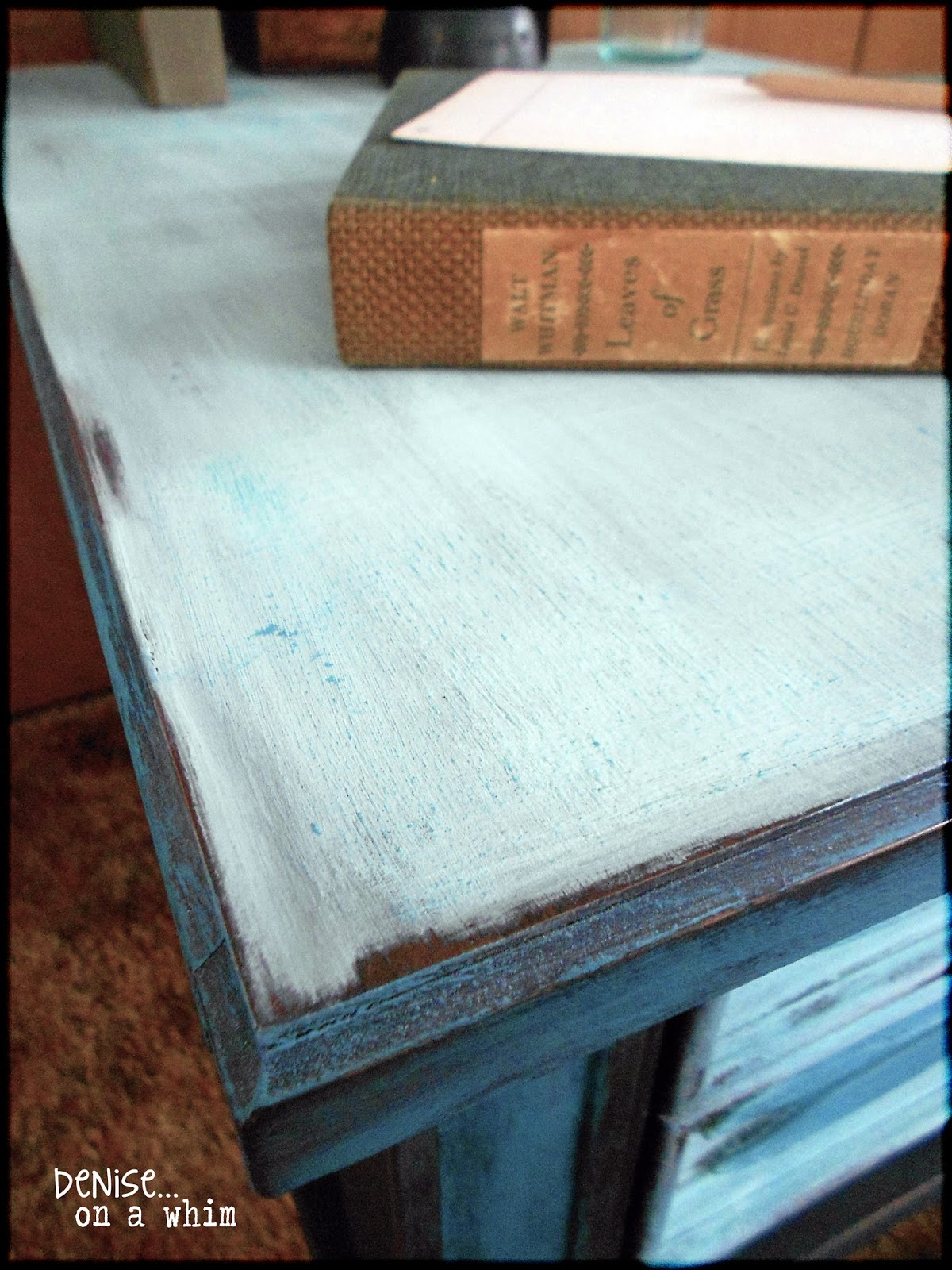 Light distressing on the edges of an end table via http://deniseonawhim.blogspot.com