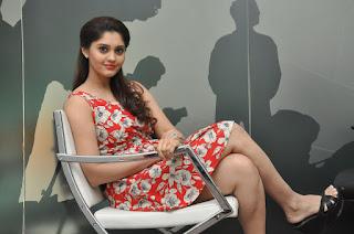 Surabhi from movie Express Raja in Beautiful Flower Print Sleeveless Short Gown Stunning Pics