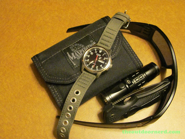 Citizen BM8180-03E Men's Eco-Drive Watch, Shown With Oakley Shades, Maxpedition Wallet, iTP flashlight and Spyderco Native Pocket Knife