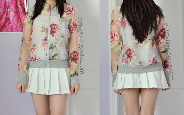 Front and back views of the organza floral bomber jacket from Dresslink, modeled with a white pleated tennis skirt.