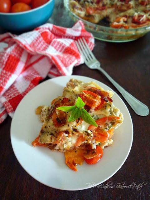 http://themccallumsshamrockpatch.com/2014/08/28/southern-tomato-pie-with-bacon/