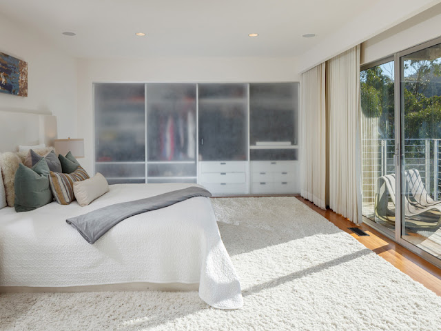Picture of modern bed in the bedroom, looking towards the window