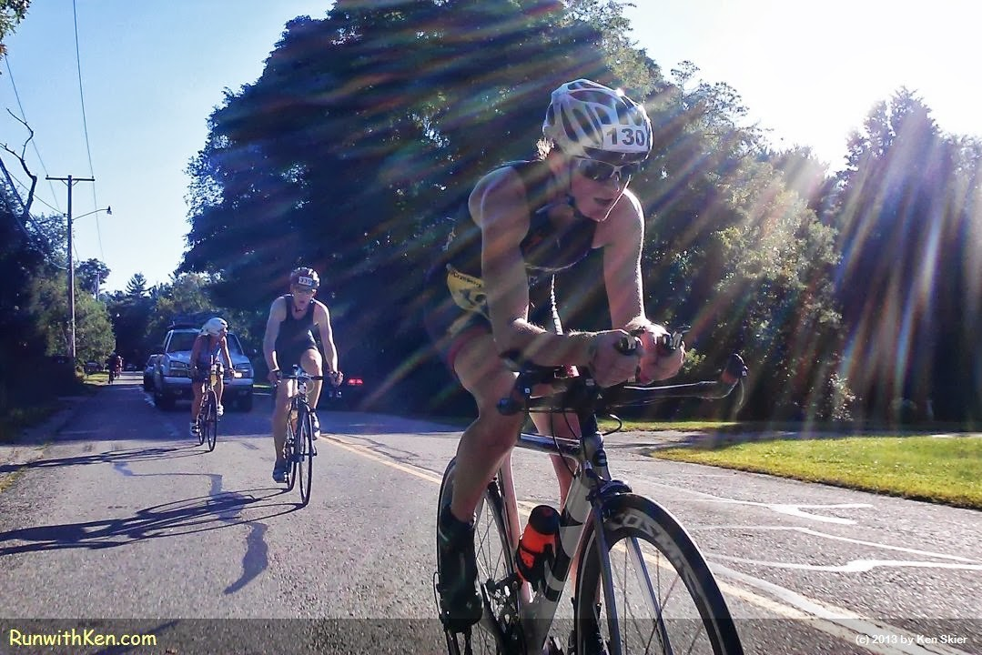 Cyclists CUT through rays of morning sun!  At the Cranberry Sprint Triathlon in Lakeville, MA.