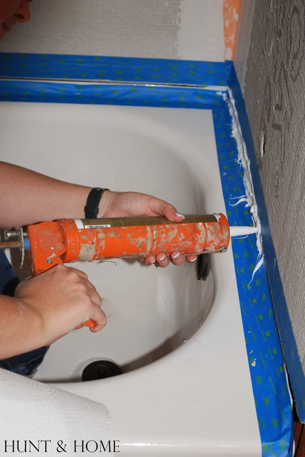how to caulk tub flange and cement board