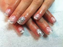 Acrylic layered Shellac specials French white acrylics with a little added interest with simple nail art.