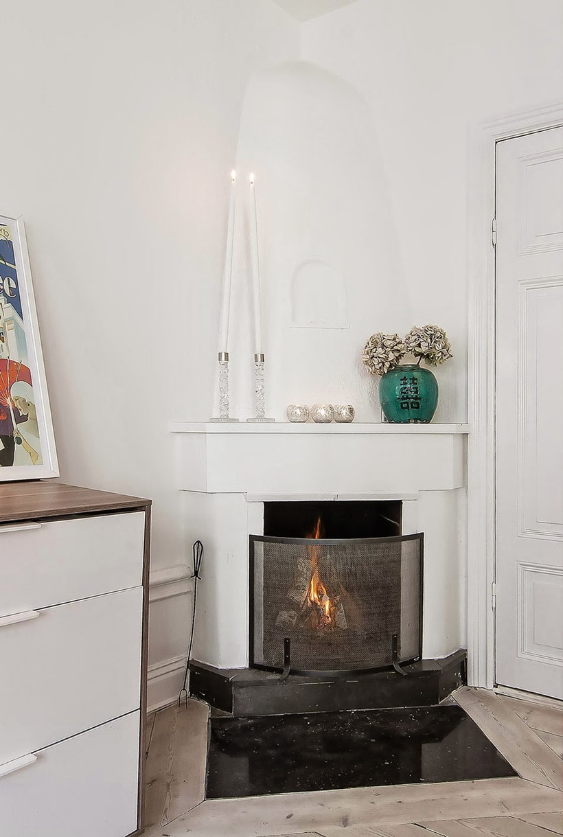 Fireplace in small modern apartment