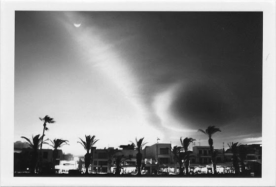 dirty photos - et - a black and white photo of clouds on a windy day in rethymno