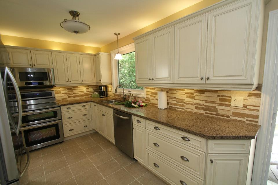 cream kitchen cabinets with white appliances images