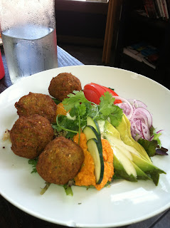 Falafel Bowl from Sage Vegan Bistro with hummus, cucumber, avocado, tomatoes and red onion for lunch