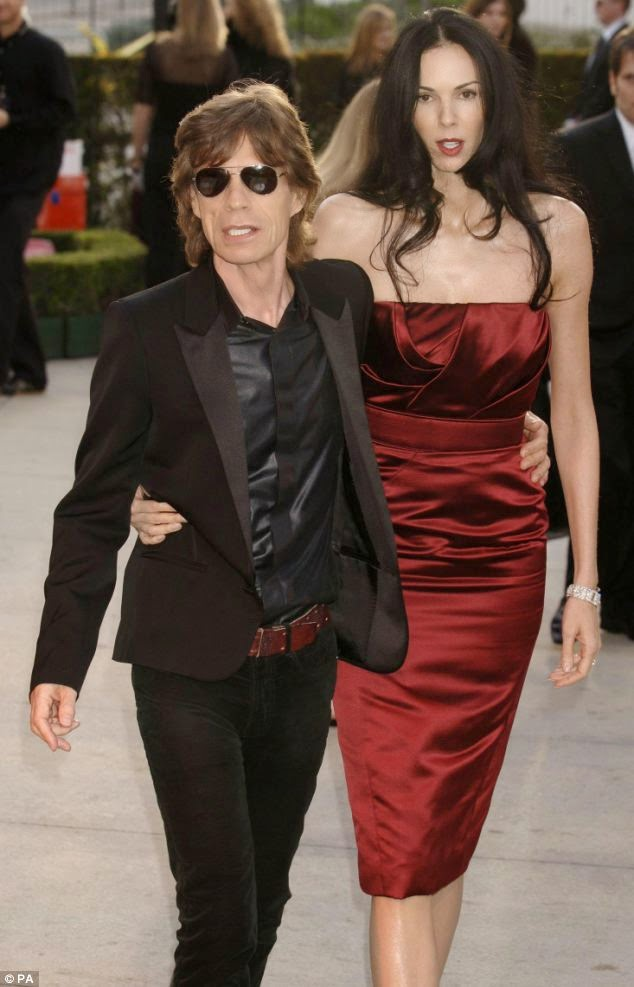 The 70-year-old, Mick Jagger seemed pleased to his music salary as he was snapped hanging out with a young mystery brunette at the hotel in Zurich, Switzerland on Saturday, June 7, 2014.