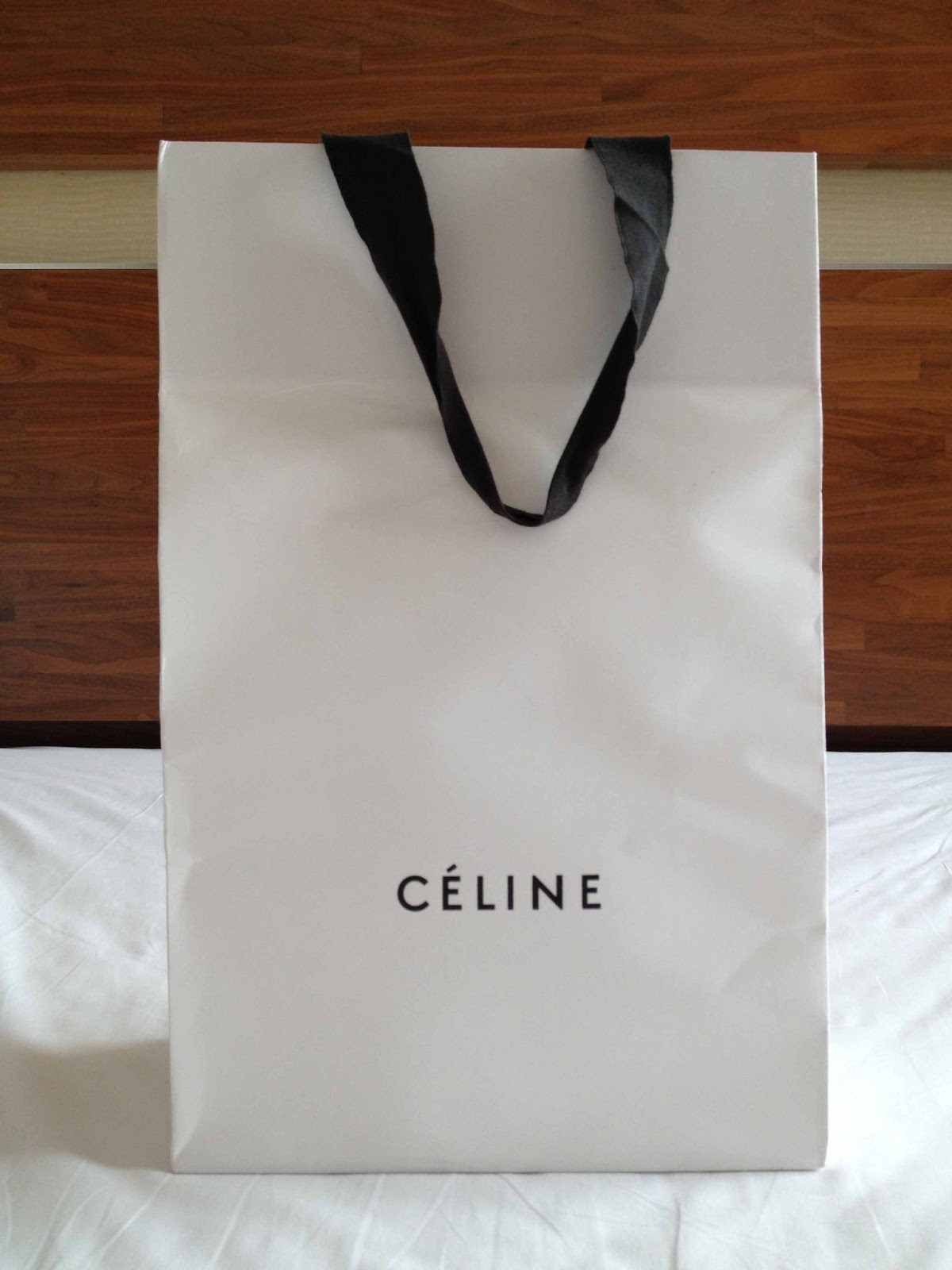 ... shopping list  the trio. So on the very first day we arrived, I dragged  Hubby to the Céline boutique in Landmark Central and came home with this  baby. ae8f7ef2c1