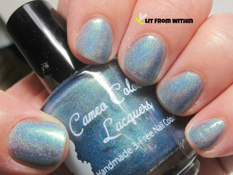 Cameo Colors Lacquer Welcome To The Universe, a shimmering Caribbean blue holo