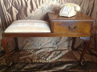 Phone table with padded seat: $130.  Old Style touch button phone: $20.