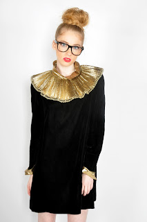 Vintage 1960's black velvet dolly dress with large gold bib neckline and matching gold cuffs.