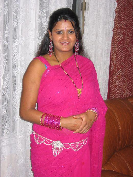 Spicy Desi Aunties of Real Life in Saree And Cleavage Photo
