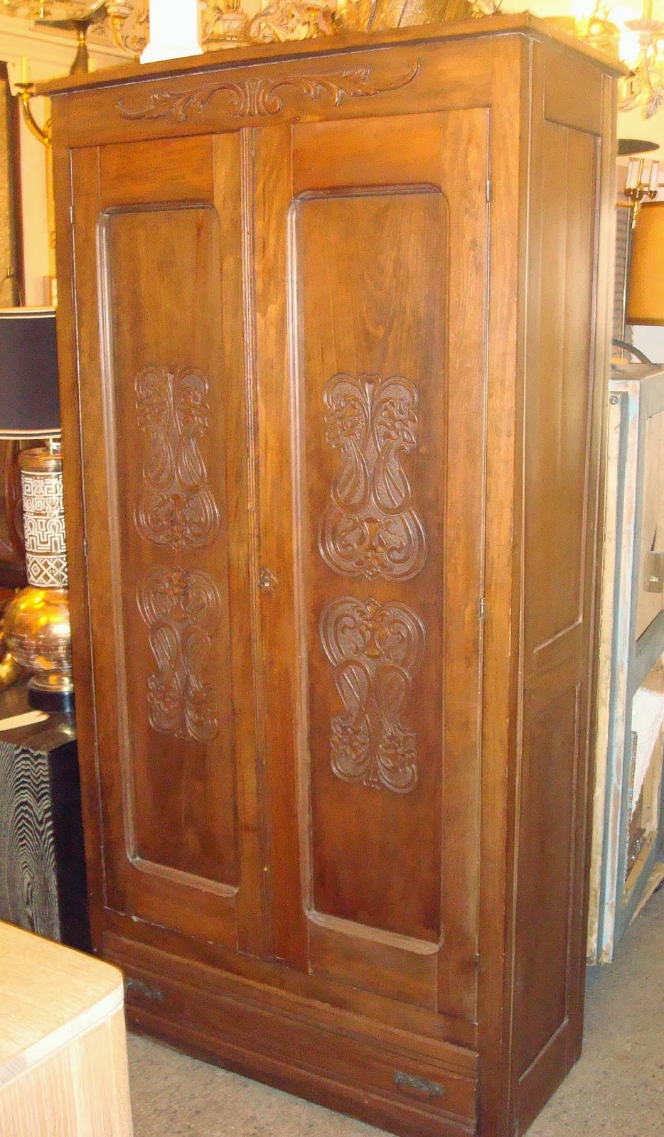 era antiques edwardian armoire with art nouveau designs embossed on both doors. Black Bedroom Furniture Sets. Home Design Ideas