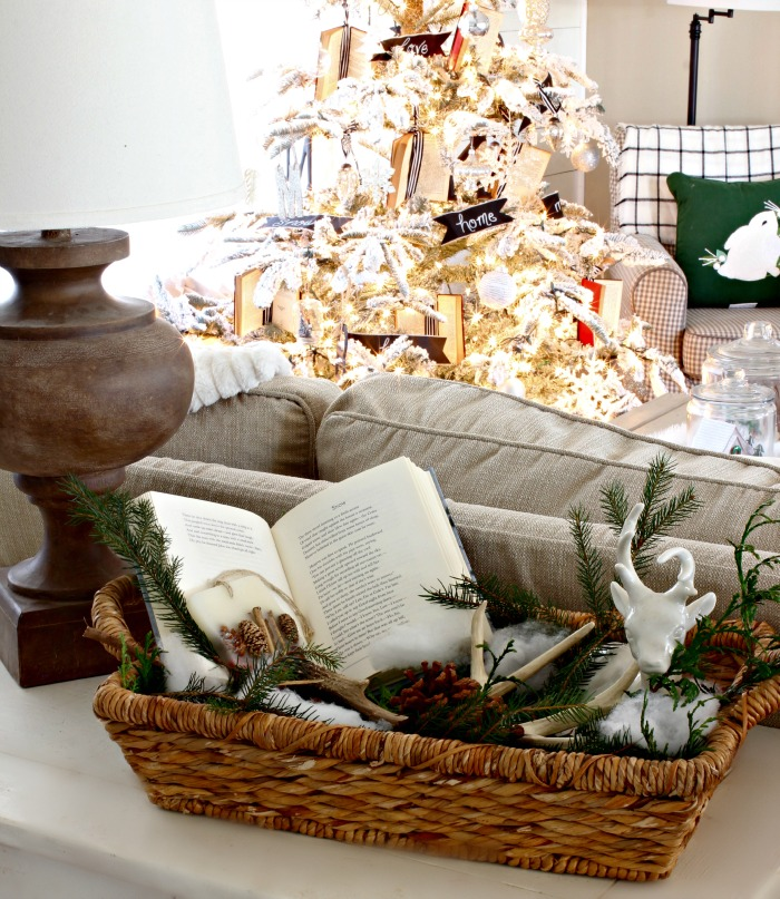 Basket with fresh evergreen clippings, book, antlers - www.goldenboysandme.com