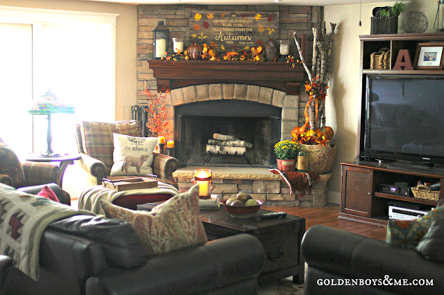 Family Room with corner stone fireplace and brown leather sofas and pallet sign, part of Fall Home Tour via www.goldenboysandme.com